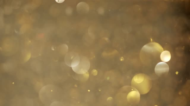 abstract golden bokeh background with shining defocus sparkles - bokeh stock videos & royalty-free footage
