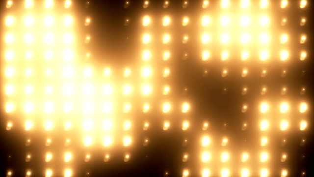 Abstract golden floodlight light wall loopable background Loopable floodlight flashing light wall VJ loop in gold color 4K background floodlit stock videos & royalty-free footage