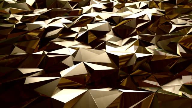 soyut altın üçgen arka plan - altın metal stok videoları ve detay görüntü çekimi