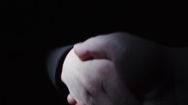 Abstract handshaking in the darkness video