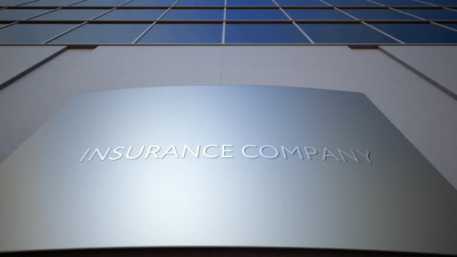 abstract insurance company signage board. modern office building. fullhd clip - insurance filmów i materiałów b-roll