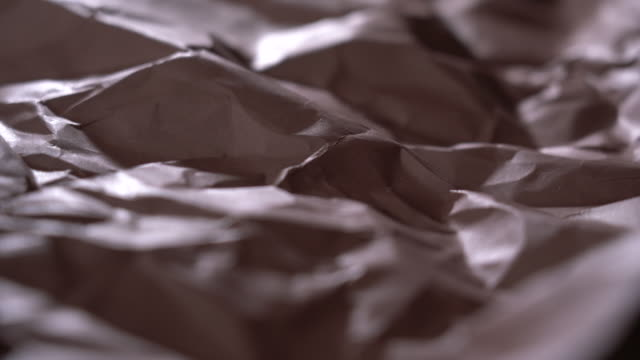 Abstract landscape of brown wrinkled paper