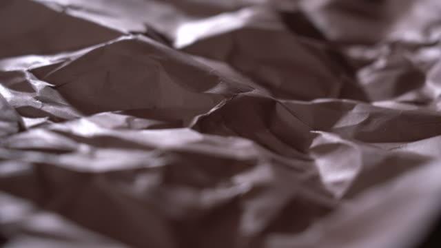 vídeos de stock e filmes b-roll de abstract landscape of brown wrinkled paper - castanho