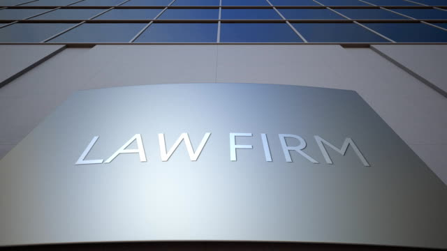 Abstract law firm signage board. Modern office building. FullHD clip video