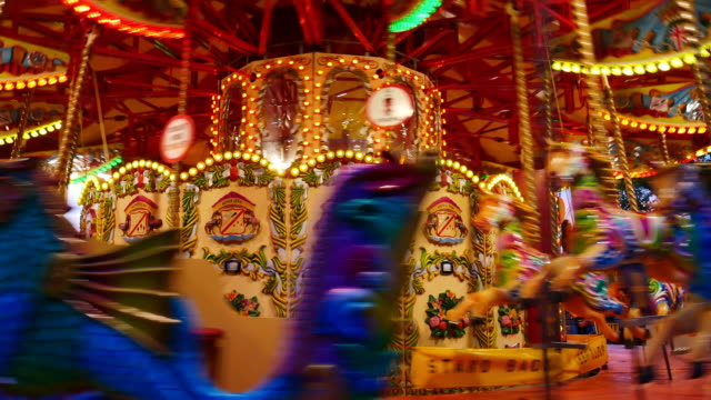 4K Abstract light Carousel, circus and Amusement park with kids, London video