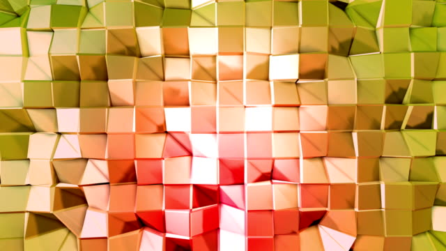 Abstract low poly style looped background. 3d seamless animation in 4k. Modern gradient colors. Low poly red green surface v1 video
