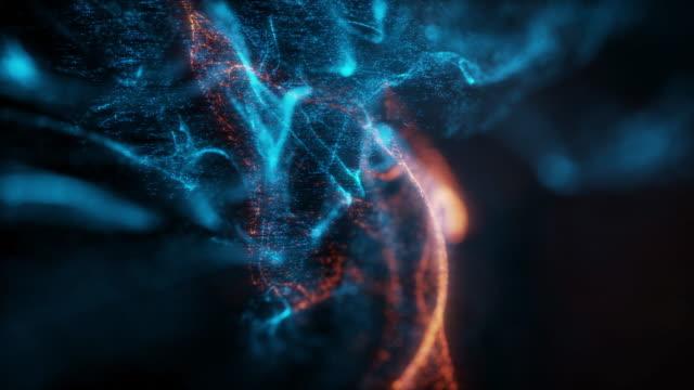 abstrakte makro-zeitlupenaufnahme von blau- und orange partikelflüssigkeit isoliert auf schwarz. - sternennebel stock-videos und b-roll-filmmaterial