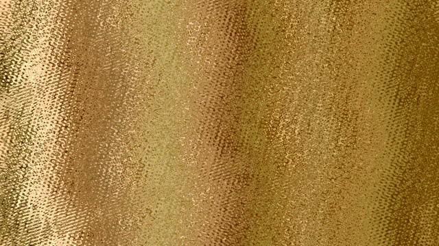 hareketli arka plan olmadan büyük motifler ovaları, altın renkli parlak ve dalgalı ışıklı ve bir cam ile görüldü - altın metal stok videoları ve detay görüntü çekimi