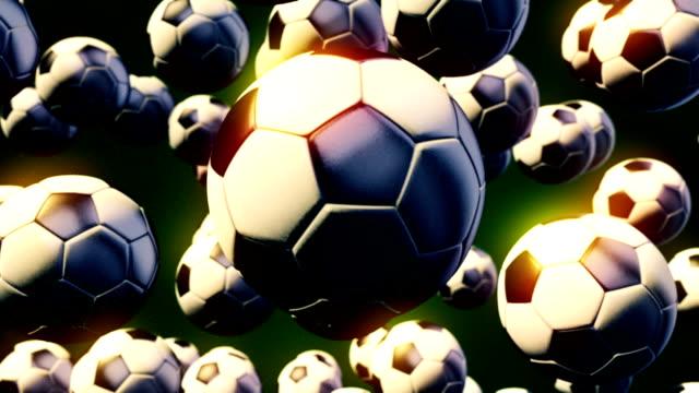 stockvideo's en b-roll-footage met abstracte bewegende beelden van cgi met vliegende voetballen - sportcompetitie