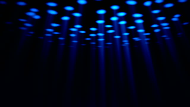 Abstract moving blue spotlights. Black background. video