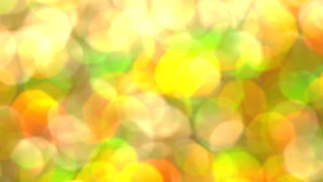 vídeos de stock, filmes e b-roll de brilhos e luzes de blured abstrata brilho multicolor de ensolarado - colorful background