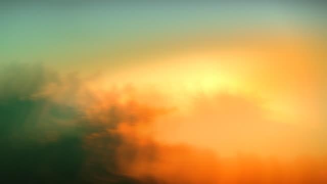 Abstract or sky background. Defocused clouds. Loop. Timelapse. Sunset video