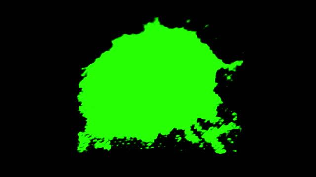 abstract paint brush stroke shape white ink splattering flowing and washing on chroma key green screen, ink splatter splash effect - schizzare video stock e b–roll