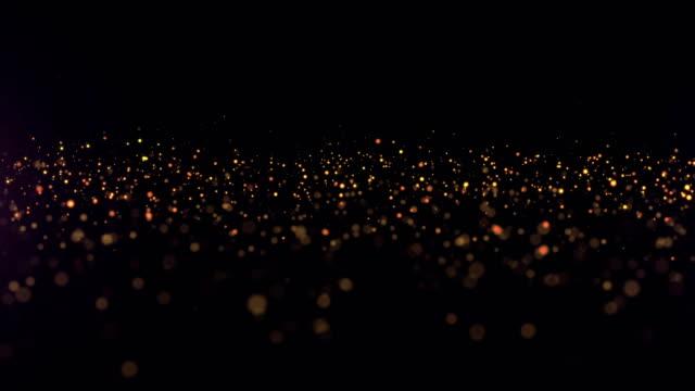 vídeos de stock, filmes e b-roll de abstrato de partículas. fundo cinematográfico. loop - eventos de gala