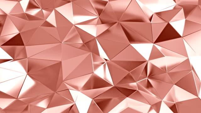 vídeos de stock e filmes b-roll de abstract polygonal background rose gold color animation - metal