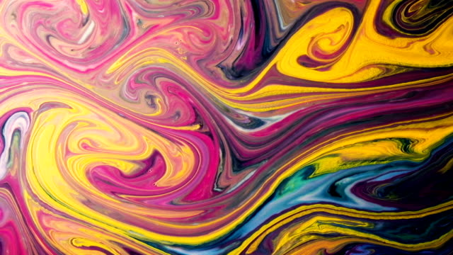 Abstract psychedelic background. Multicolored paints slowly pour into patterns in milk slow motion