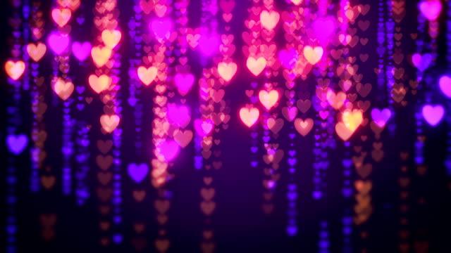 vídeos de stock, filmes e b-roll de chuva abstrata dos corações dos namorados loopable plano de fundo - símbolo do coração