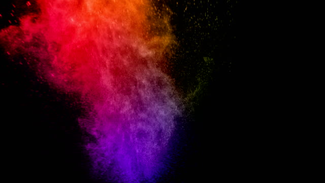 abstract real multicolor powder explosion on black background, slow motion - взрывающийся стоковые видео и кадры b-roll