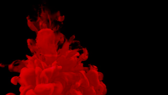 abstract red ink splash in water on black background video