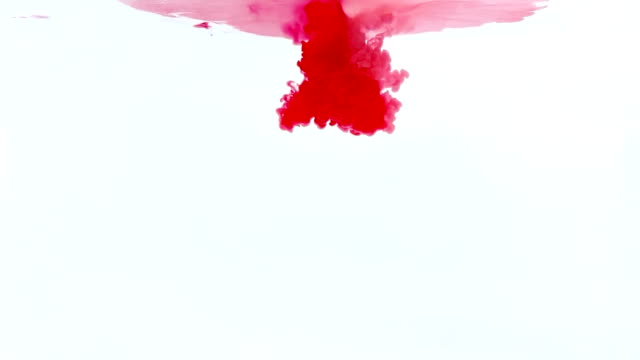 abstract red ink splash in water on white background video