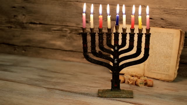abstract retro filtered low key image of jewish holiday Hanukkah with menorah traditional Candelabra video