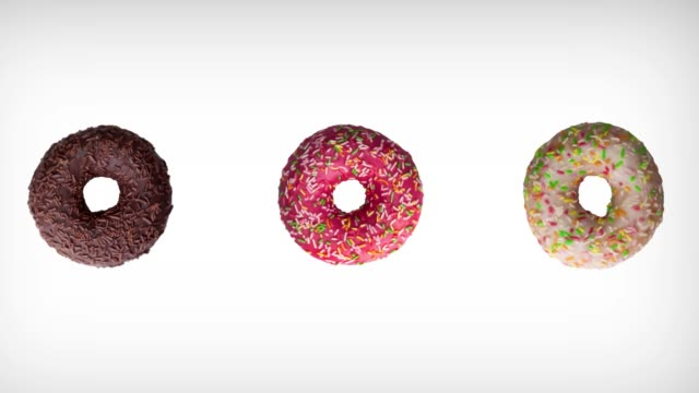 abstract rotation animation of of three different colorful donuts on white background. - bombolone video stock e b–roll