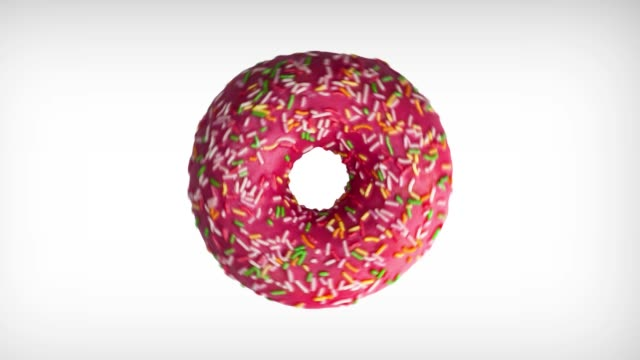 abstract rotation animation of tasty donut with colorful sprinkles on white background. - bombolone video stock e b–roll