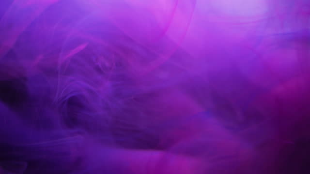Abstract smoke fog purple ink levitation background 4k abstract background levitation of smoke violet ink color in water with dark background. Using for horizontal or vertical format video purple stock videos & royalty-free footage