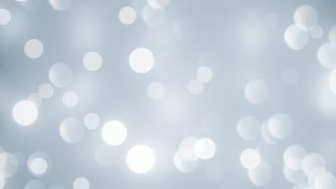 soyut yumuşak temiz bulanık glitter toz tiny hareketli rising glitter bokeh parçacıklar döngülü arka plan - işıldama stok videoları ve detay görüntü çekimi