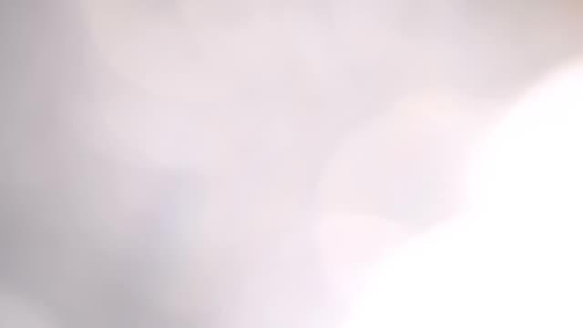 抽象的な輝く粒子の小さい大ぼけを移動 - 宝飾品点の映像素材/bロール