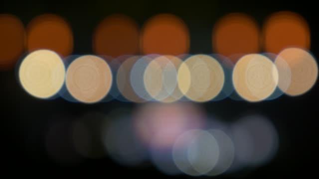 hareketli arka plan garip ışıklar - bling bling stok videoları ve detay görüntü çekimi