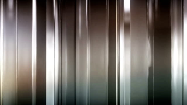 Abstract thin glass panels rotate and move in space. The panels shine and reflect each other. Looped