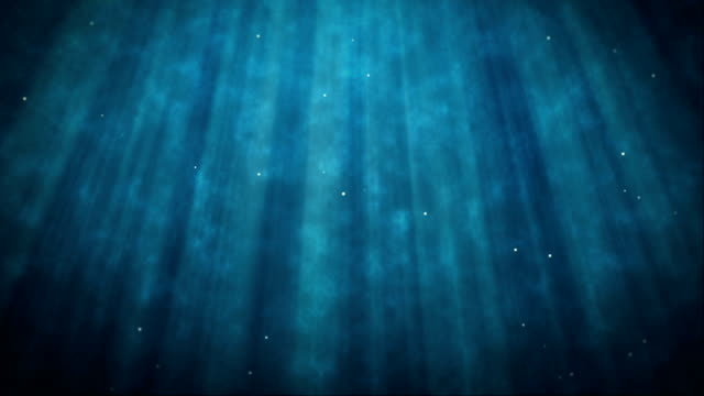 Abstract underwater light beam background video