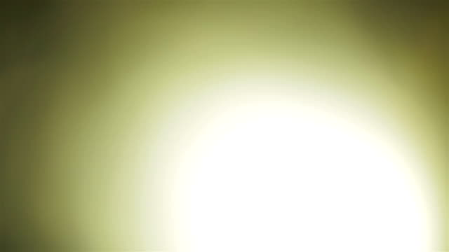 Abstract yellow light pulses and glows lights leaks effect motion background. Creative background. Lens flare video