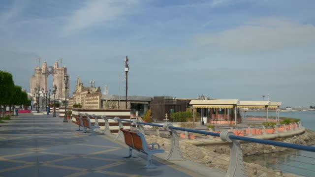 abu dhabi day time famous marina hotel construction panorama 4k united arab emirates - uae national day стоковые видео и кадры b-roll