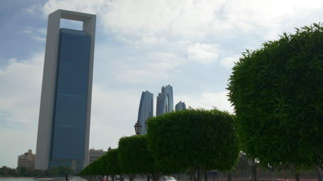 abu dhabi sunny day corniche bay oil company building panorama 4k united arab emirates - uae national day стоковые видео и кадры b-roll