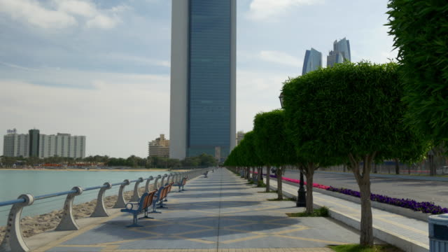abu dhabi sunny day corniche bay sidewalk panorama 4k united arab emirates - uae national day стоковые видео и кадры b-roll