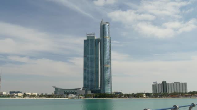 abu dhabi sunny day corniche beach bay nation towers panorama 4k united arab emirates - uae national day стоковые видео и кадры b-roll