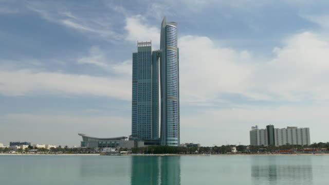 abu dhabi sunny day corniche beach bay national gallery panorama 4k united arab emirates - uae national day стоковые видео и кадры b-roll