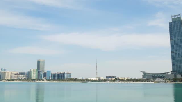 abu dhabi sunny day corniche beach bay panorama 4k united arab emirates - uae national day стоковые видео и кадры b-roll