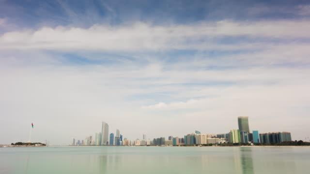 abu dhabi sunny evening marina bay corniche downtown panorama 4k time lapse uae - uae flag filmów i materiałów b-roll