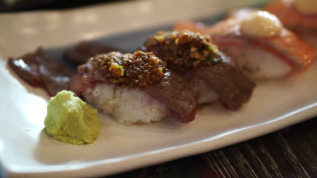 Aburi Nigiri, seared beef and salmon sushi Japanese cuisine half cook meat on top of rice video