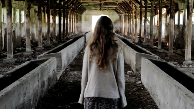 Abused Woman Walking toward Light Safety from Oppression Concept HD