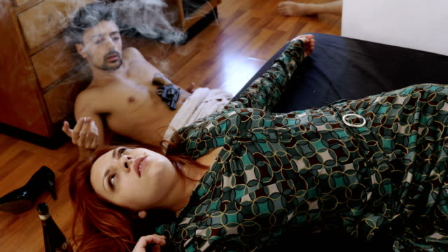 abusing of narcotic substances: couple smokes a joint focus on abusing of narcotic substances: couple smokes a joint hashish stock videos & royalty-free footage