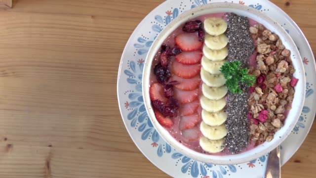 acai berry bowl with fruits and cup of coffee video