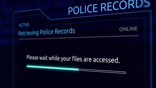 vídeos de stock e filmes b-roll de accessing confidential police records in virtual database - angle 2 - criminoso