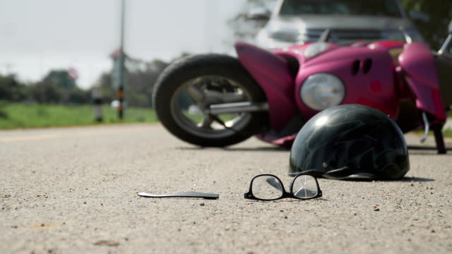 Accident motorcycle crash with car on road