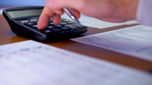 Accountant at work. Business сalculator and financial statements video