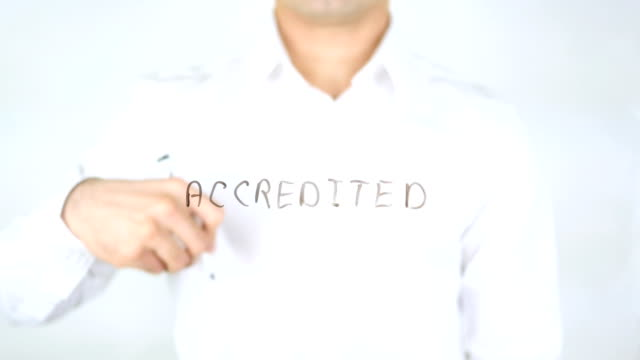 Accredited, Man Writing on Glass video