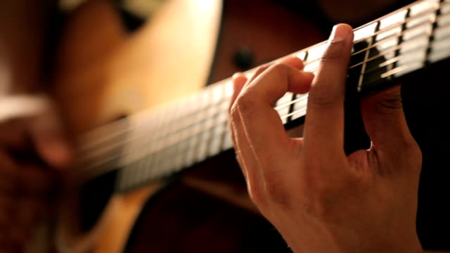 Acoustic guitar in musician hands Close up acoustic guitar in musician hands in dark room guitar stock videos & royalty-free footage
